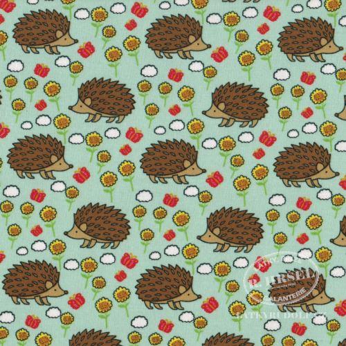 Látka Bavlněný úplet ježci na zelené 149355